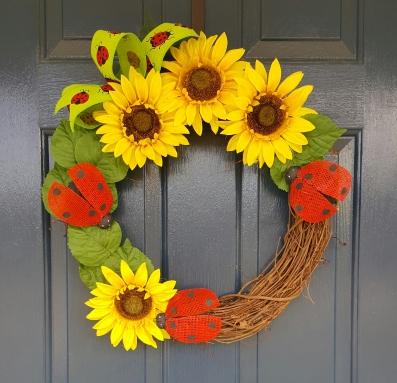 "Happy Lady Bug 16"" Grapevine wreath $50"