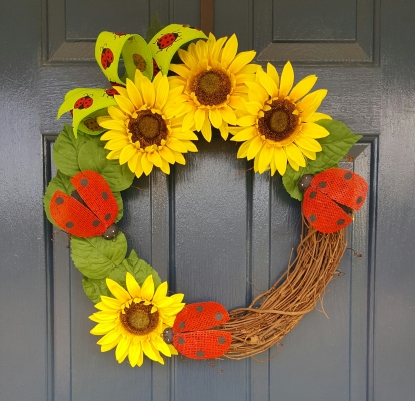 "Happy Lady Bug 16"" Grapevine wreath $50"